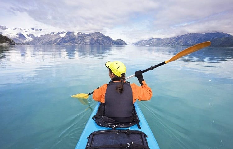 girl in kayak on the lake in winter