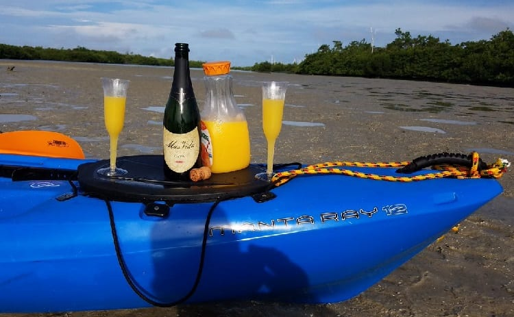 beverages and bottle of wine on kayak